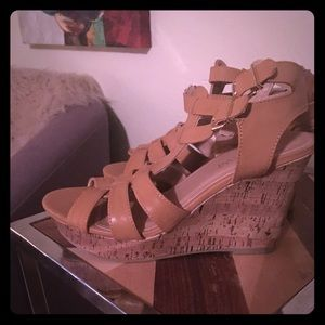 Tan cork wedges with straps.